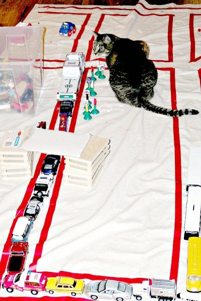 Drop cloth road for toy cars and trucks.