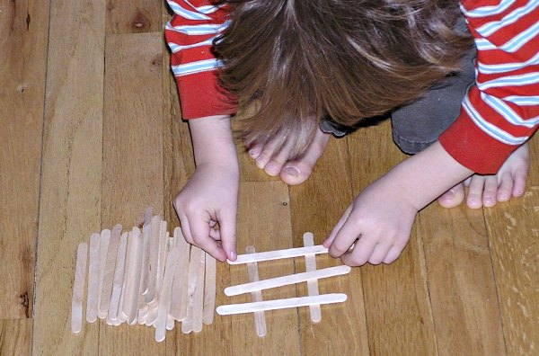 Building with crafts sticks - a fun indoor activity for kids