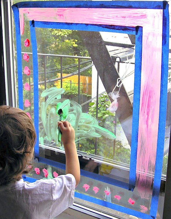 Painting on the windows is a good rainy day activity for kids