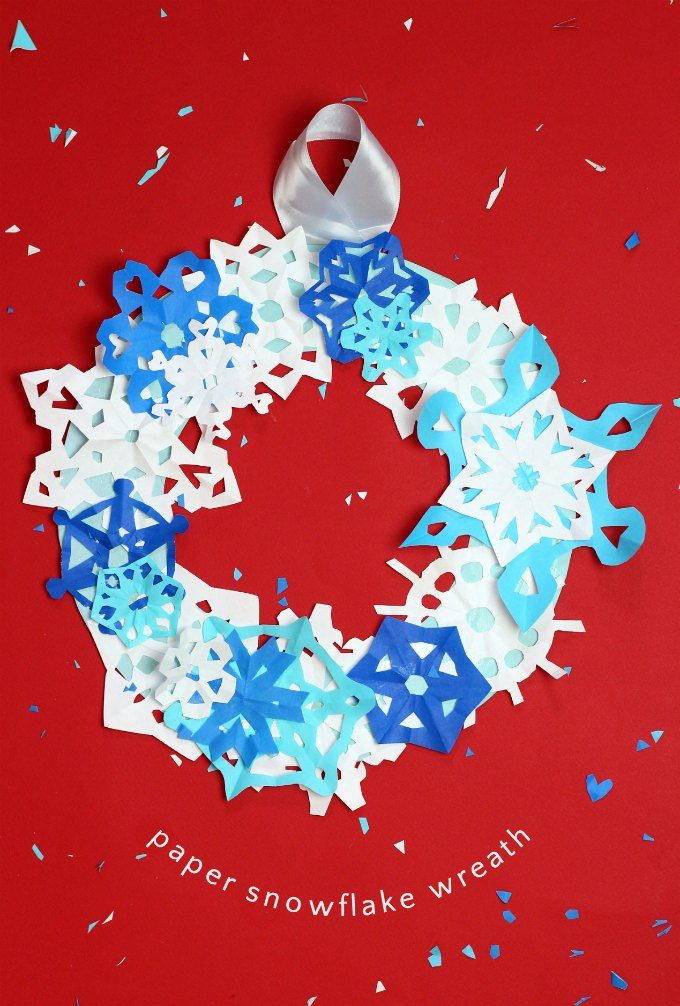 Paper snowflake winter wreath is an easy winter craft for children
