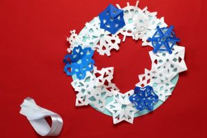 Position snowflakes on wreath