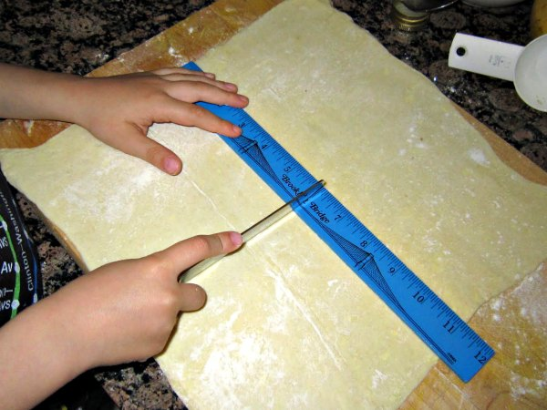 Measuring dough is good math practice for kids in the kitchen