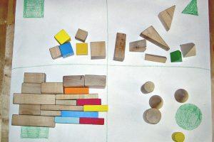 Montessori inspired shape sorting activity using geometric solids.