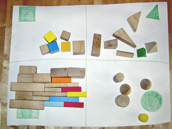 Montessori inspired shape sorting activity using geometric solids.