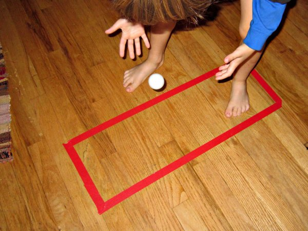 A simple rectangle of tape on the floor is a great idea for indoor play!