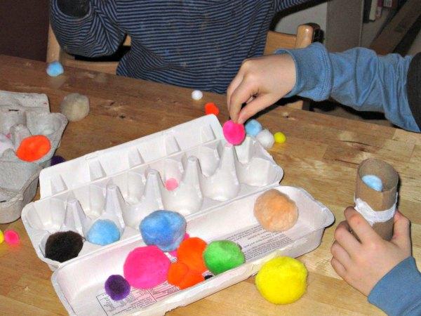Kids love to play with pom poms