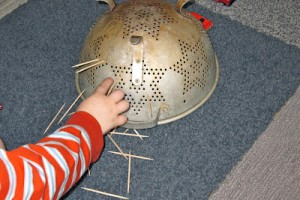 Toothpicks + Colander Fine Motor Activity