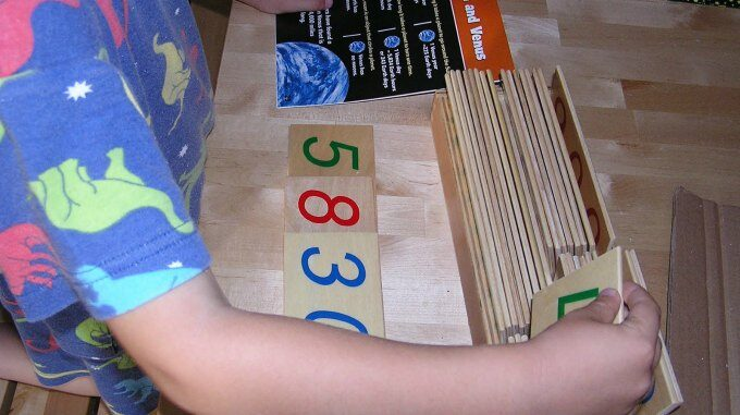 Playing with montessori number cards