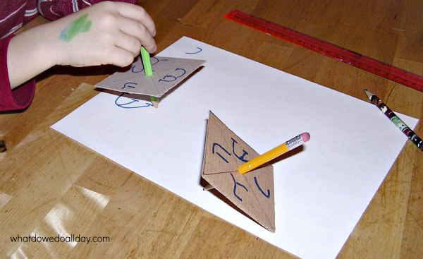 Recycled cardboard and pencil dreidel craft