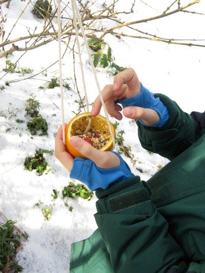 Hanging orange bird feeder craft for kids