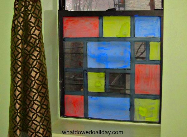 Have your kids transform your windows into a Mondrian stained glass panel.