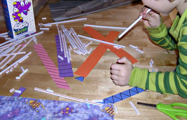 Fine motor activity for kids cutting straws with scissors