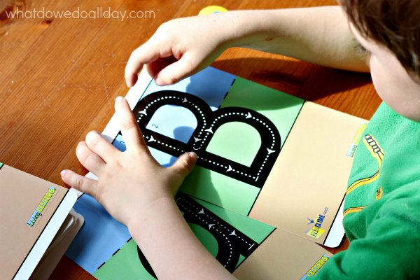 Learning letter formation with alphabet cards.