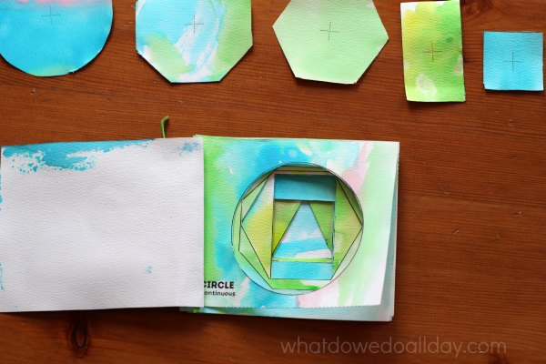 Mat art project shapes book to show relative size.