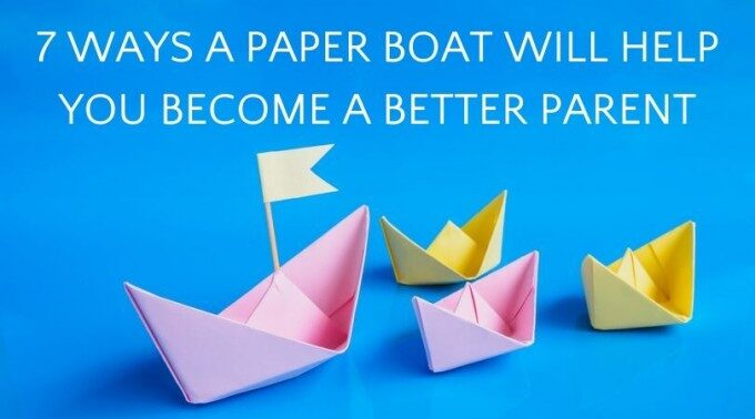 Large paper boat followed by three smaller boats