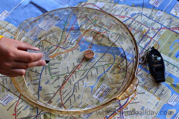 Using a homemade compass to explore map science.