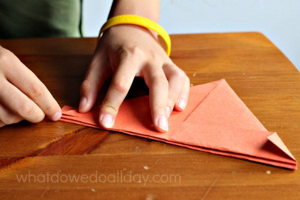 Folding paper boats and crafting with kids