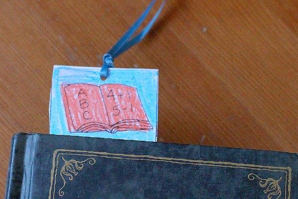 School bookmark in book.