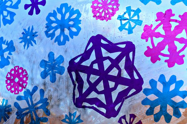 Snowflake faux stained glass window art project for kids