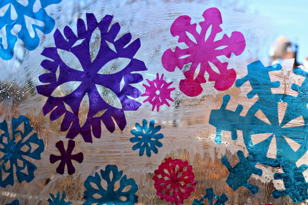 Snowflake stained glass window art with cellophane