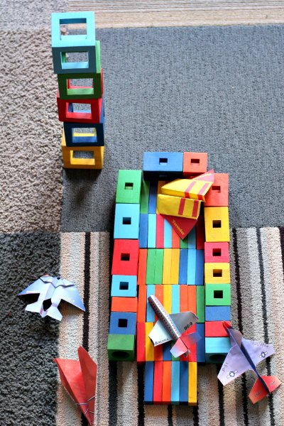 Block landing strip for paper airplane games at home.
