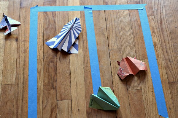 Tape landing strip for paper airplane games.