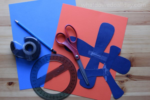 Supplies for making a paper boomerang
