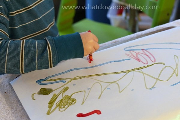 Drawing with melting crayon art project for kids.