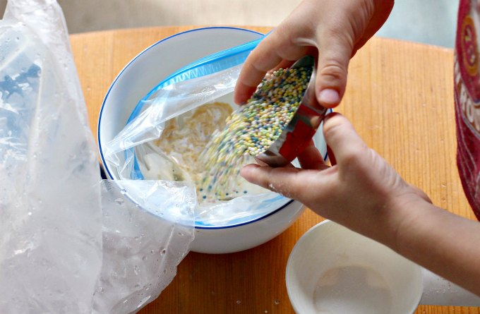 Pouring ingredients for ice cream in a bag.