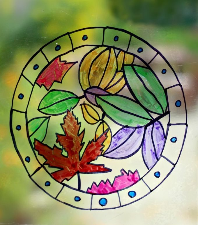 Beautiful fall leaf suncatcher craft from a versatile coloring page template