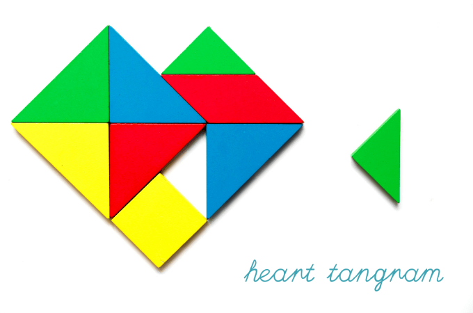 Heart tangram with colorful wooden blocks