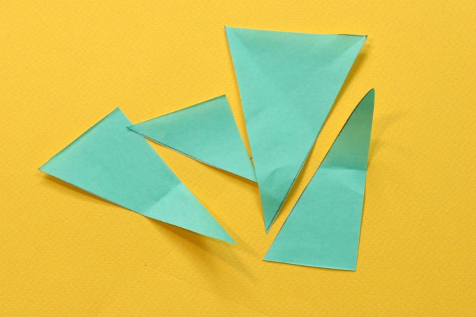 Mixed up pieces of paper triangle puzzle