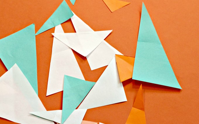 Mixed up triangle paper pieces