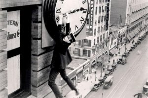 Harold Lloyd hanging off clock in safety last