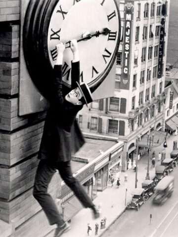 Harold Lloyd hanging off clock in safety last