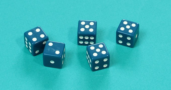 Five dice showing fives four and two
