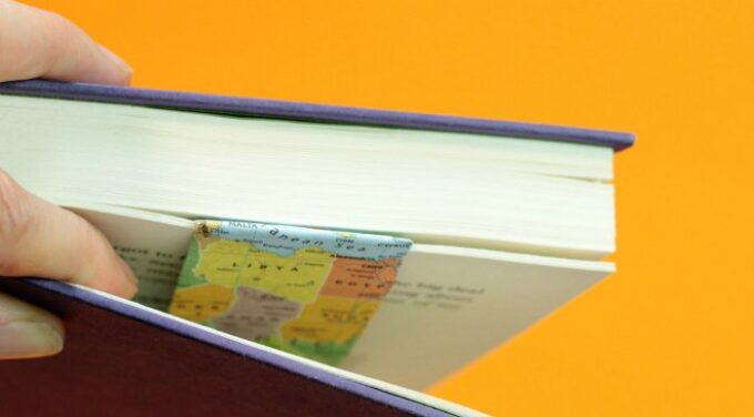 Open book with map decorated bookmark