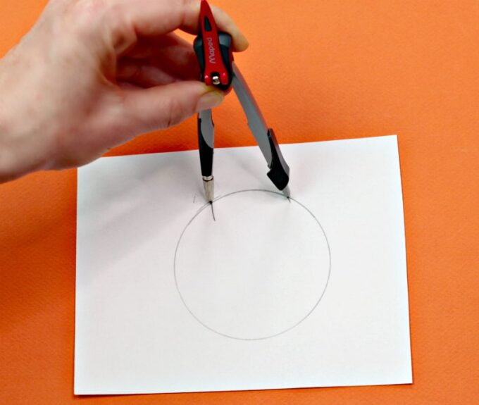 Drawing a circle with a compass