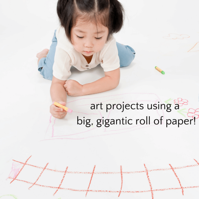 Child drawing on big roll of paper