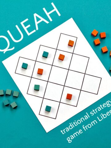 Board game and tokens for Queah strategy game