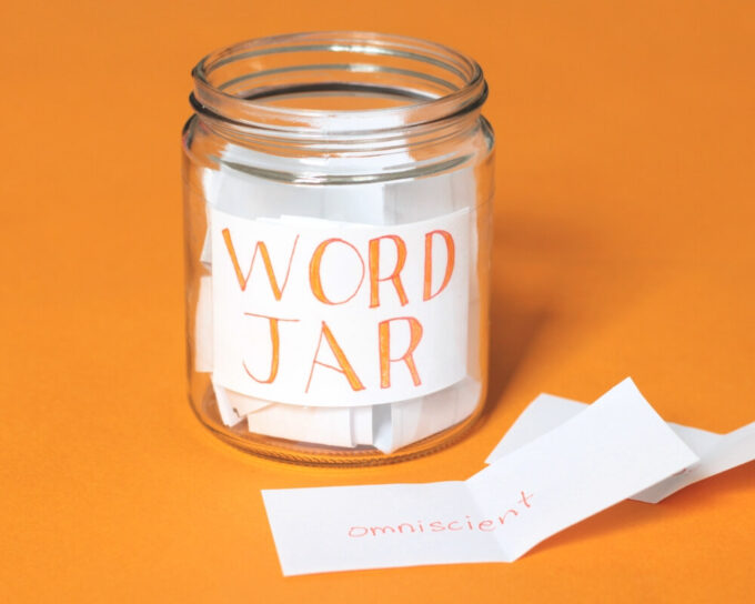 Glass jar filled with slips of paper