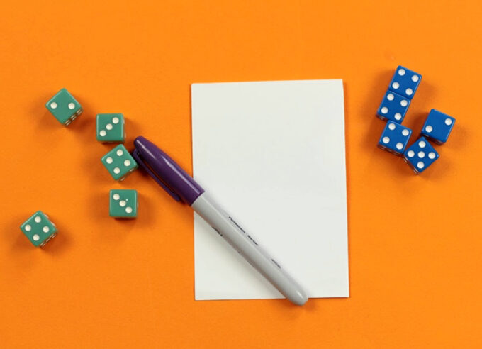 pen paper and 10 dice for addition and subtraction dice game