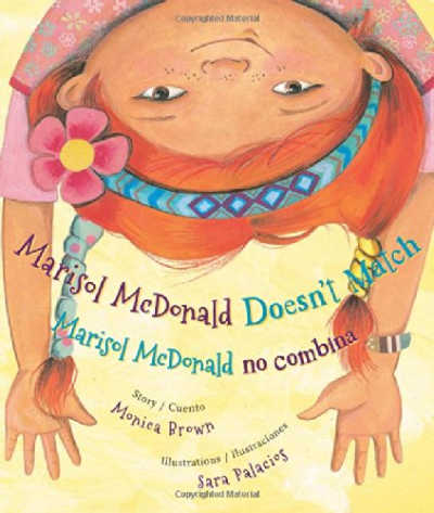 marisol mcdonald book cover showing upsidedown red haired girl