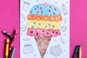 ice cream cone coloring page on pink background with crayons