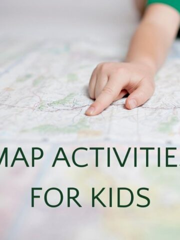 child's hand pointing to location on map