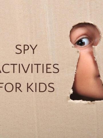 child looking through keyhole in cardboard