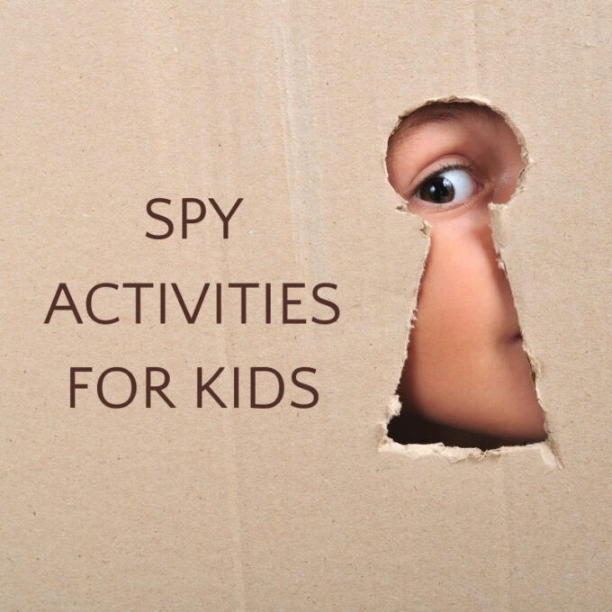 child looking through keyhole in cardboard