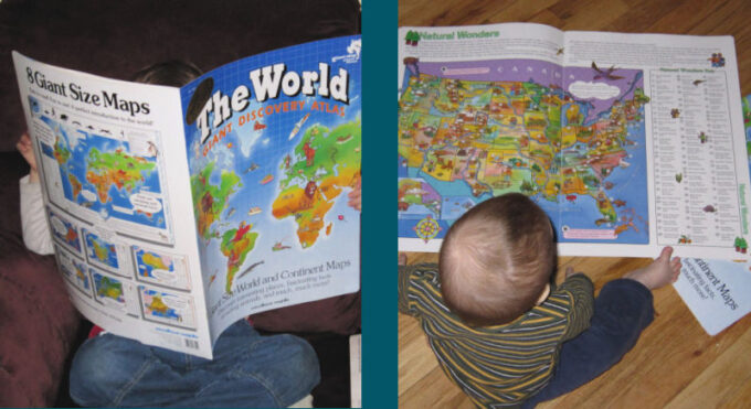 child reading an atlas