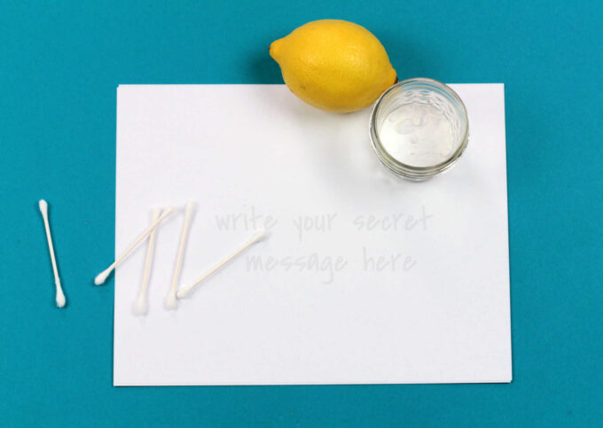 blank paper with q-tips, lemon and jar