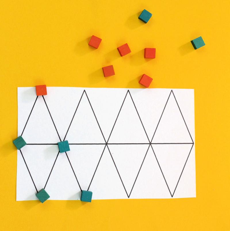 kolowis awithlaknannai game board with 4 remaining tokens